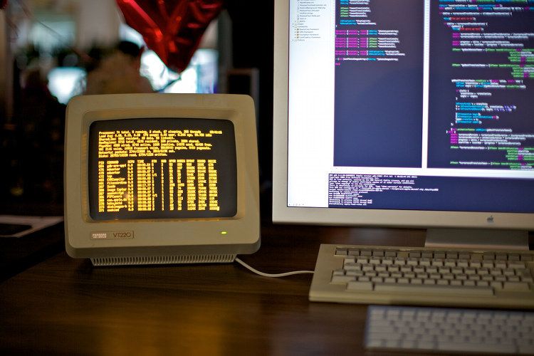 A vintage VT220 hardware terminal hooked up to a Mac Pro